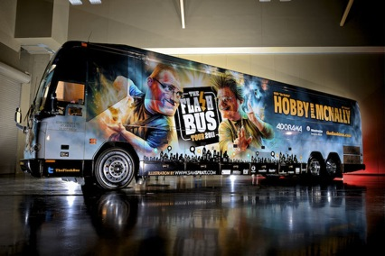 Photo of a large tour bus lit with portable flash units.